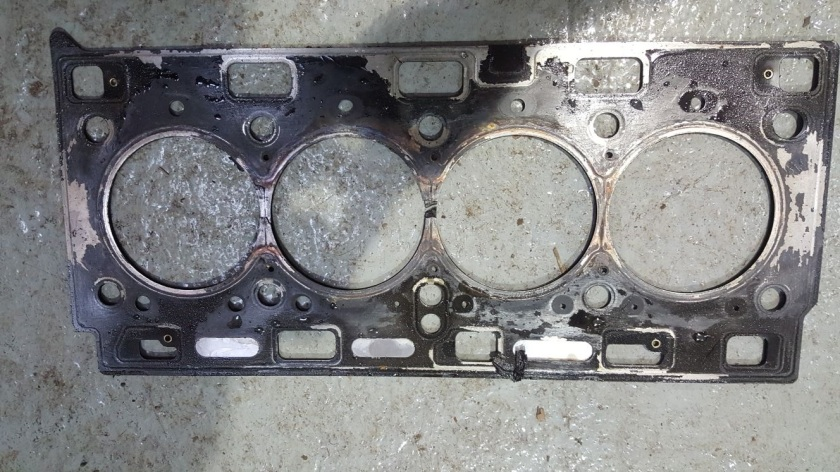 Head gasket blown between 2 cylinders